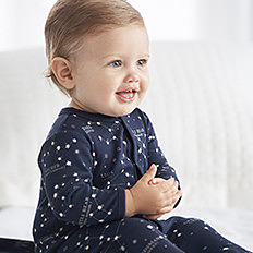 RALPH LAUREN CHILDREN'S CLOTH a baby boy wearing a navy onesie with white dots. shop baby boys TALJCWR