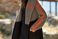 The perfect snuggle-up layer for winter, our felted knit coat is a soft