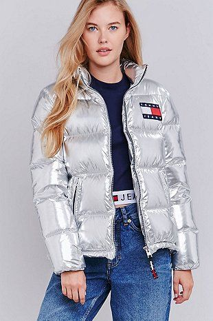 Gigi Hadid cuts a stylish figure in silver Tommy Hilfiger jacket
