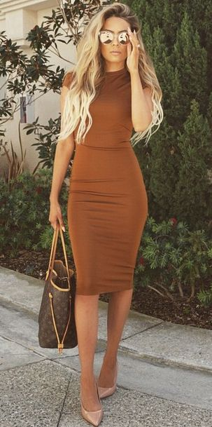 Rust bodycon dress w/Louis Vuitton bag & CL pumps. Add a cropped